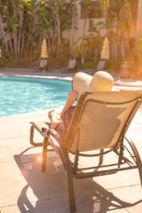 SMOV cancer survivor Shannon Phillips lounging in a pool chair at GPP